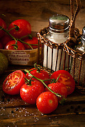 Tomatillios on wooden crate green mottled background