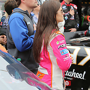 Racecar driver Danica Patrick is seen with boyfriend and Sprint Cup driver Ricky Stenhouse Jr. on the starting grid during the National Anthem, prior to racing in the NASCAR DRIVE4COPD 300 auto race at Daytona International Speedway on Saturday, February 22, 2014 in Daytona Beach, Florida.  (AP Photo/Alex Menendez)