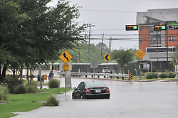 (170827) -- HOUSTON, Aug. 27, 2017 (Xinhua) -- A vehicle is stranded in flood near the China Town of Houston, Texas, the United States, Aug. 27, 2017. Widespread and worsening flood conditions prompted the closure of nearly every major road in Houston as the outer bands of Hurricane Harvey swept through the Houston area over the weekend. Latest news reports said the storm death toll has climbed to at least 5. (Xinhua/Liu Liwei) (Photo by Xinhua/Sipa USA)