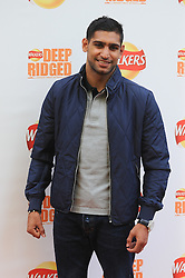 © Licensed to London News Pictures. 29/08/2012. London,UK.Amir Khan attending to the launch of new Walkers Deep Ridged crisps.To celebrate the launch Walkers will unveil 'Britain's Biggest Ever Crisp', a 22m high x 26m .Photo credit : Thomas Campean/LNP. .