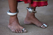 Elderly Indian woman with ankle bracelets and toe rings at home in Narlai village in Rajasthan, Northern India