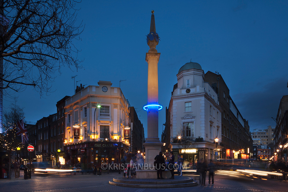 Plunge project by Arts Admin and artist Michael Pinsky. The monument in Seven Dials has been fitted with a ring of blue light at 28m above sea levels to indicate where the sea levels will be in 1000 years time if we, the human race, continue our CO2 emmissions at current rate. An estimated hight of raised seal levels will be 28m, based on current available science. 3 monuments in London have been fitted with a ring of light at 28 m above sea levels, one is on the Duke of York Monument, another the monument in Paternoster Square and the third on the monument in Sevel Dials in Covent Garden.