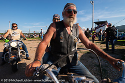 Peggy McStott and Randy Elletson on his 1965 electroglide at the Spirit of Sturgis races at the fairgrounds during the Sturgis Black Hills Motorcycle Rally. Sturgis, SD, USA. Monday, August 5, 2019. Photography ©2019 Michael Lichter.