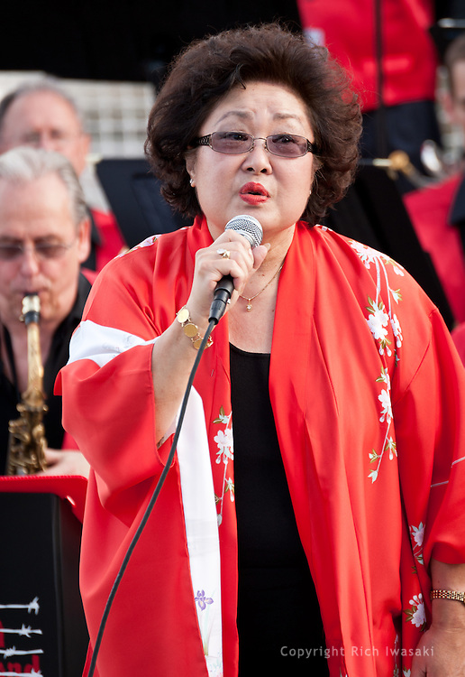 Vocalist Nola Bogle performs with the Minidoka Swing Band at the Bill Naito Legacy Fountain at Waterfront Park, Portland, Oregon. The July 2010 performance was part of the festivities around the rededication of the Japanese American Historical Plaza.