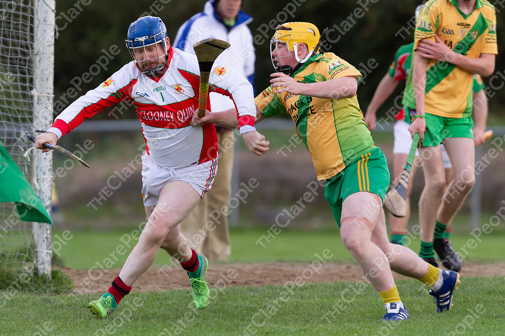 Clooney/Quin's goalie Patrick Cunningham is tackled by O'Callaghan's Mills Jamie Keane
