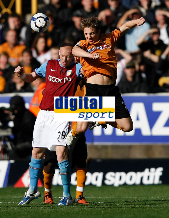 Photo: Steve Bond/Richard Lane Photography. Wolverhampton Wanderers v Aston Villa. Barclays Premiership 2009/10. 24/10/2009. Kevin Doyle leaps in front of James Collins