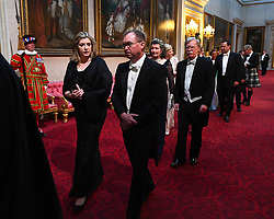 Secretary of State for Defence, Penny Mordaunt and John Michael Mulvaney arrive through the East Gallery during the State Banquet at Buckingham Palace, London, on day one of the US President's three day state visit to the UK.