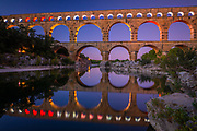 The Pont du Gard is an aqueduct in the South of France, in the Provence province, constructed by the Roman Empire, and located in Vers-Pont-du-Gard near Remoulins, in the Gard  département.