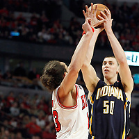 16 April 2011: Indiana Pacers power forward Tyler Hansbrough (50) takes a jumpshot over Chicago Bulls center Joakim Noah (13) during the Chicago Bulls 104-99 victory over the Indiana Pacers, during the game 1 of the Eastern Conference first round at the United Center, Chicago, Illinois, USA.