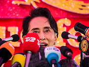 "05 NOVEMBER 2015 - YANGON, MYANMAR: AUNG SAN SUU KYI smiles during a press conference. During the press conference, which lasted 90 minutes, Aung San Suu Kyi, the leader of the National League for Democracy (NLD), said that if the NLD won the election she would serve ""above"" the President. When questioned about the Rohingya crisis in western Myanmar, a reporter called the situation ""dramatic"" and Suu Kyi replied the entire country is in a ""dramatic situation"" and the problems of the Rohingya should not be ""exaggerated."" She said the ""great majority of our people remain as poor as ever."" She also said the NLD would make a ""fuss"" if election results were ""suspicious."" Citizens of Myanmar go to the polls Sunday November 8 in what is widely viewed as the most democratic and contested election in Myanmar's history. The NLD is widely expected to win the election.   PHOTO BY JACK KURTZ"