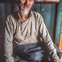 Sherpa elder Kunchok Chombi, a veteran of Hillary's l 1952  Everest expedition, sits by a window in a house in Namche Bazaar, the biggest town in Nepal's Khumbu region.