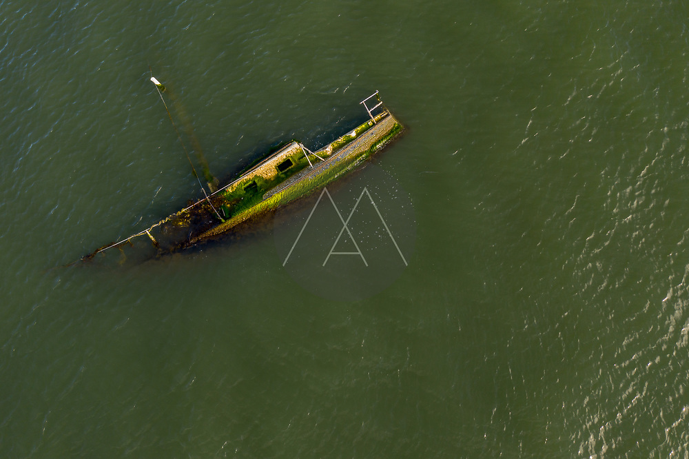 Aerial view of a boat wreck sinking at Indian River Lagoon, Florida, United States.