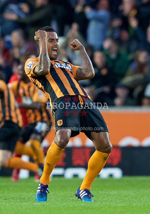 KINGSTON-UPON-HULL, ENGLAND - Tuesday, April 28, 2015: Hull City's Michael Dawson celebrates scoring the winning goal against Liverpool with team mate Tom Huddlestone celebrating in the front during the Premier League match at the KC Stadium. (Pic by Gareth Jones/Propaganda)