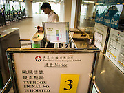 13 AUGUST 2013 - HONG KONG:  A typhoon warning sign on the Star Ferry pier in Hong Kong during Typhoon Utor. Typhoon Utor (known in the Philippines as Typhoon Labuyo) is an active tropical cyclone located over the South China Sea. The eleventh named storm and second typhoon of the 2013 typhoon season, Utor formed from a tropical depression on August 8. The depression was upgraded to Tropical Storm Utor the following day, and to typhoon intensity just a few hours afterwards. The Philippines, which bore the brunt of the storm, reported 1 dead in a mudslide and 23 fishermen missing at sea. The storm brushed by Hong Kong bringing several millimeters of rain and moderate winds to the island but causing no reported damage or injuries. It is expected to make landfall in China.  PHOTO BY JACK KURTZ