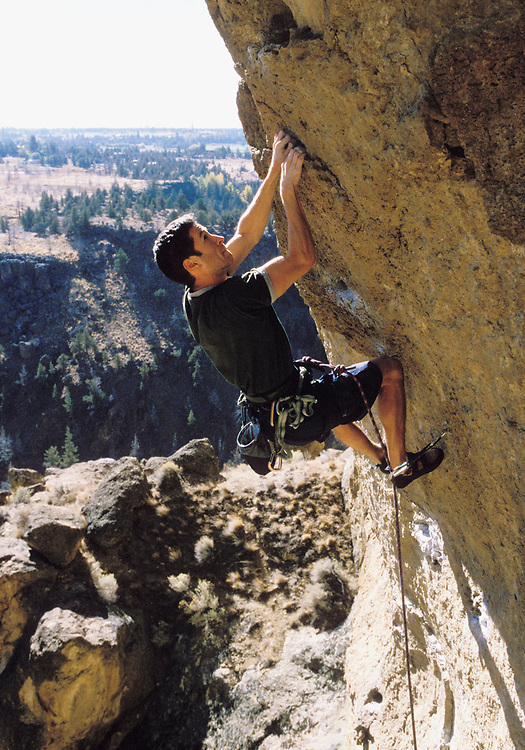 A man rock climbing at Smith Rock State Park in Oregon, USA.