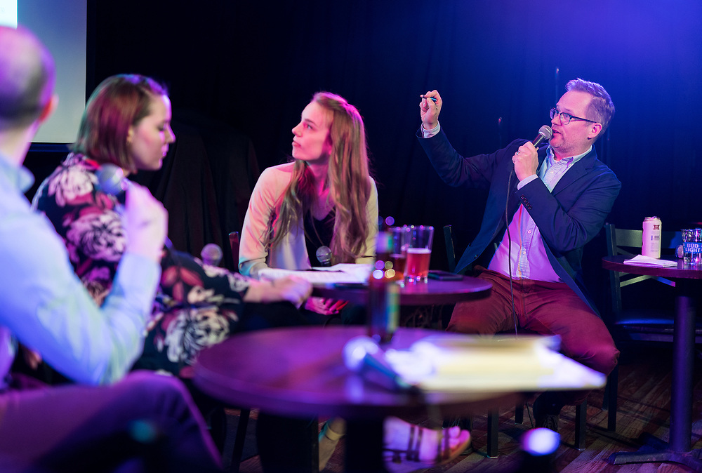 """Jason Joyce points out election districts during the live taping of the """"Madsplainers"""" Podcast at High Noon Saloon in Madison, WI on Tuesday, April 9, 2019."""