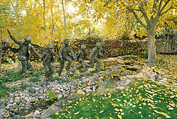 Puddle Jumpers, a sculpture by Santa Fe artist Glenna Goodacre, accents a fall scene in the garden at Nedra Metteucci Galleries in Santa Fe