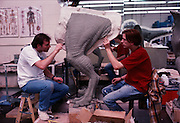 At Stan Winston Studios outside L.A. in Van Nuys, CA., the dinosaurs for Steven Spielberg's action epic, Jurassic Park are being created.  Artists work on the clay legs of Velociraptor.