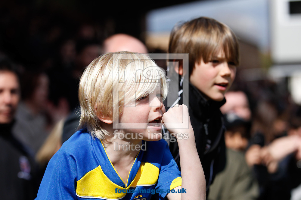 Picture by Andrew Tobin/Focus Images Ltd +44 7710 761829.27/04/2013. A young AFC Wimbledon supporter clenches his fist to encourage his team during the npower League 2 match at the Cherry Red Records Stadium, Kingston.