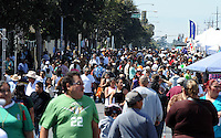 """Sunday's crowd at the """"El Grito"""" celebration in Salinas marking September 16th's anniversary of Mexico's independence from Spain. The annual fiesta, which occupies East Alisal Street between Wood and Sanborn, brimmed as usual with booths selling patriotic souvenirs and all manner of food and drink. Local businesses and nonprofits manned booths with information about health and community programs, while traditional """"bandas"""" filled the afternoon with dance music and good cheer."""