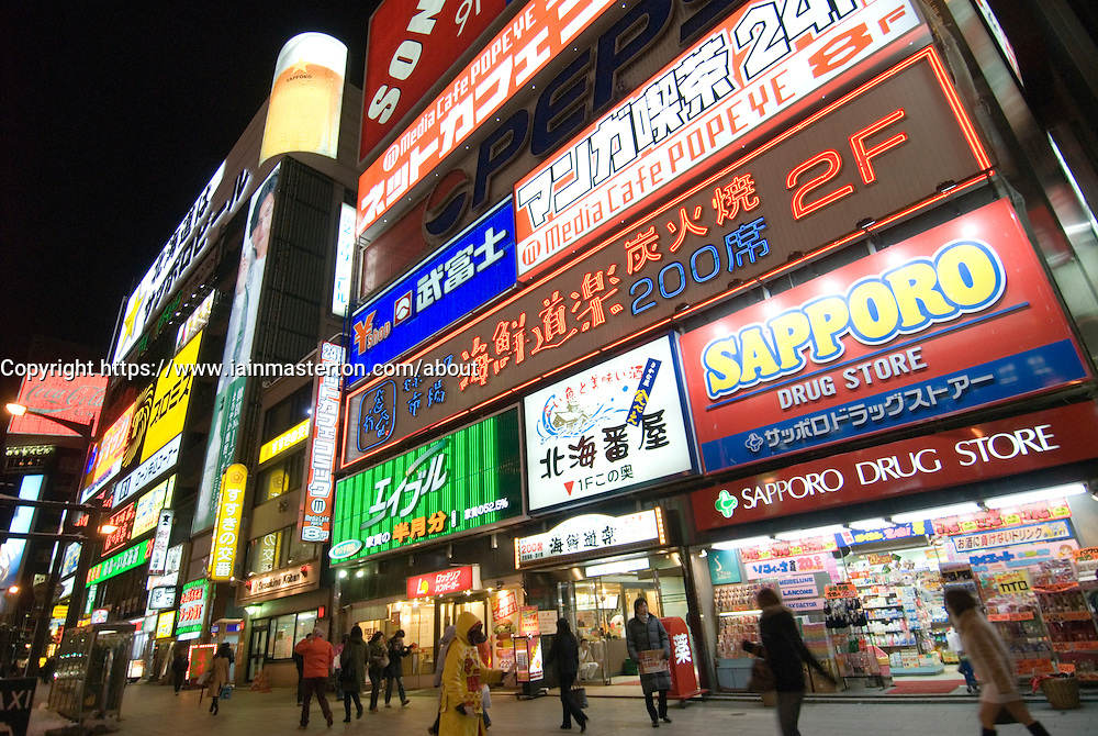 Many illuminated signs on buildings in Susukino entertainment district of Sapporo in Hokkaido Japan