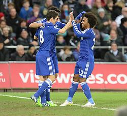 Chelsea's Willian celebrates with Chelsea's Oscar and Chelsea's Diego Costa - Photo mandatory by-line: Alex James/JMP - Mobile: 07966 386802 - 17/01/2015 - SPORT - football - Swansea - Liberty Stadium  - Swansea  v Chelsea  -