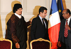 Libyan Foreign Minister Abdel-Rahman Shalgham, President Nicolas Sarkozy and Libyan leader Moammar Gadhafi attend a signing ceremony at the Elysee Palace in Paris, France on December 10, 2007. The French presidency announced the signature of 10 billion euros of trade contracts between France and Libya, as well as an agreement to supply 'one or more nuclear reactors' to Libya. Photo by Ammar Abd Rabbo-Mousse/ABACAPRESS.COM