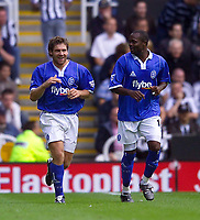 Photo. Jed Wee<br /> Newcastle United v Birmingham City, FA Barclaycard Premiership, St. James' Park, Newcastle. 30/08/2003.<br /> Birmingham's David Dunn (L) smiles in relief after scoring from the rebound having first had his penalty saved.