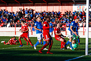 Accrington Stanley defender Michael Ihiekwe (4), on loan from Rotherham United, on the floor scores a goal to make the score 1-1 during the EFL Sky Bet League 1 match between Accrington Stanley and Portsmouth at the Fraser Eagle Stadium, Accrington, England on 27 October 2018.
