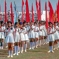 Bengali youth groups march at a stadium in Dhaka, Bangladesh, celebrating thier recent independence from Pakistan. 1977 photo