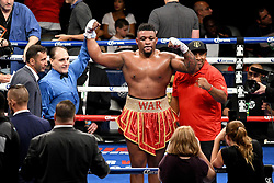 July 29, 2017 - Brooklyn, New York, USA - JARRELL MILLER (red trunks with gold trim) celebrates after defeating GERALD WASHINGTON in a heavyweight bout at the Barclays Center in Brooklyn. (Credit Image: © Joel Plummer via ZUMA Wire)