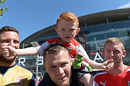A young Arsenal fan chanting with his family outside Emirates Stadium before k/o. Barclays Premier League, Arsenal v West Ham Utd at the Emirates Stadium in London on Sunday 9th August 2015.<br /> pic by John Patrick Fletcher, Andrew Orchard sports photography.