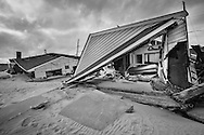 November 18, Ocean Beach, NJ, Beach front home destroyed by Superstorm Sandy's surge. Hurricane Sandy hit the Jersey Shore as a tropical storm causing billions of dollars of damage and cutting electricity to hundreds of thousands. Extreme weather is being blamed on climate change by many scientist.