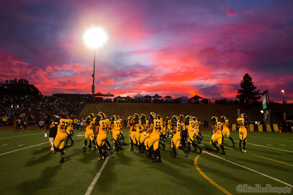 The Del Oro Eagles warm up on the field before start of the game as they host the Kamehameha Warrior's at the Honor Bowl at Del Oro High School, Friday August 29, 2014. Kamehameha won the game 24-17.<br /> Brian Baer/Special to the Bee
