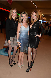 Left to right, Charlotte Munford, Lisa Tchenguiz and Shadi Ritchie at the Masterpiece Midsummer Party in aid of Marie Curie Cancer Care held at The Royal Hospital Chelsea, London on 2nd July 2013.