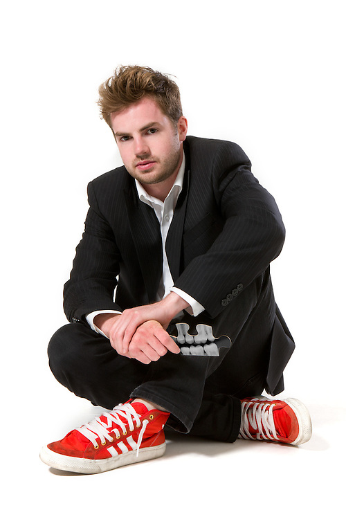 A young CEO with his crazy orange shoes
