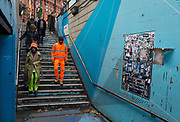 Londoners descend the underpass steps leading into the Old Street station in Shoreditch, on 4th November 2019, in London, England.
