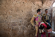 Mexican Matador Arturo Macias, left, and fellow bullfighter Paco Urena wait to enter the ring at the Plaza de Toros in San Miguel de Allende, Mexico.