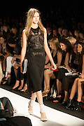A black dress with black lace accents and a harness detail at the BCBGMAXAZRIA show at the Spring 2013 Mercedes Benz Fashion Week show in New York.