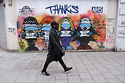Thanks to the NHS street artwork on Oxford Street which is empty of shoppers as the national coronavirus lockdown three continues on 28th January 2021 in London, United Kingdom. Following the surge in cases over the Winter including a new UK variant of Covid-19, this nationwide lockdown advises all citizens to follow the message to stay at home, protect the NHS and save lives.