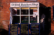 AE2CH2 Small traditional local butcher shop Orford Suffolk England