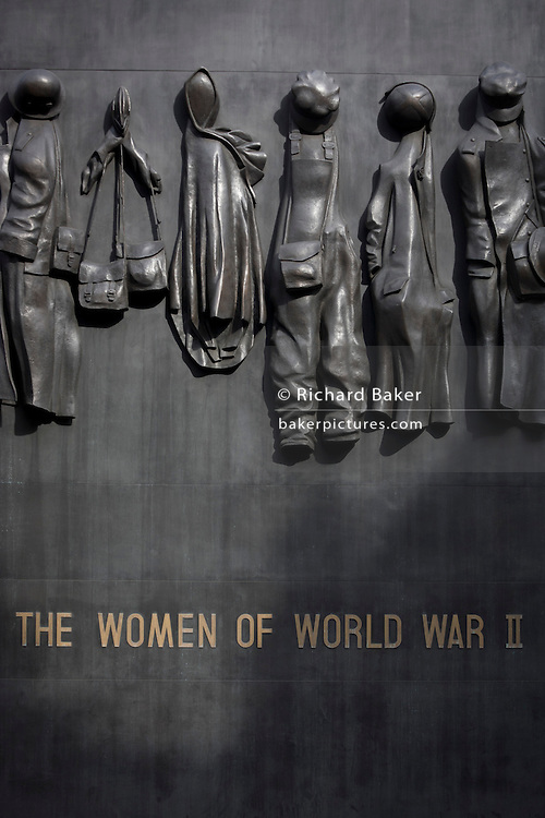 Detail of the cenotaph dedicated to the women of world war 2, in Whitehall, Westminster London. The Monument to the Women of World War II is a British national war memorial situated on Whitehall in London, to the north of the Cenotaph. It was sculpted by John W. Mills, unveiled by Queen Elizabeth II and dedicated by Baroness Boothroyd in July 2005.