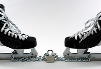 29 July 2004:  Two CCM ice hockey skates under lock and chain. Photo Illustration for the CBA lockout. The National Hockey League and NHL Players Union are still undergoing talks of a new labor agreement.  Owners want cost certainty, players do not want a salary cap. Average salary of an NHL player is $1.8 million (US) and is taking up to 75% of the leagues revenues.  Players salaries have grown 261% since the 1995 agreement.  Current agreement is due to expire on September 15, 2004. Mandatory Credit:  Shelly Castellano/Icon SMI