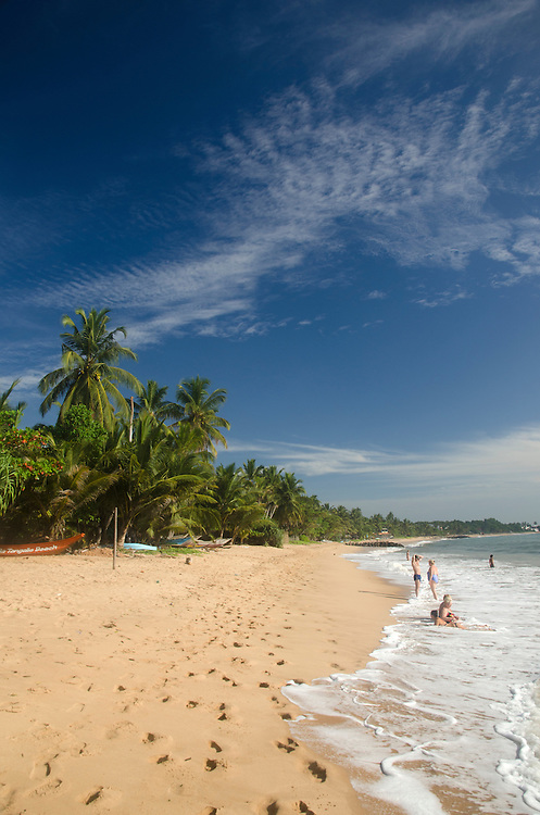 Tourists on the Tangalle beach in Sri Lanka