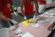 man serving a Spumoncino, a typical ice cream dessert