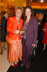 Left to right, DAWN GIBBINS winner of the 2002 Veuve Clicquot Award and MARIE-CLAIRE BROAD-DAVIES at a reception for the winners of the 2006 Veuve Clicquot Award - Business Woman of the Year held at Claridge's Hotel, brook Street, London on 27th April 2006.  This years winner was Vivienne Cox, BP CEO for Gas, Power, Renewables and Integrated Supply & Trading.  The awards were presented by the Rt.Hon.Gordon Brown MP - The Chancellor of the Exchequer.<br />