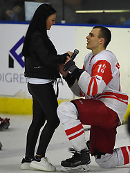 Cape Town 180420 Giorgia player Vasilchenko Aleksander proposes to his girlfriend after their last game  in a Ice Hokey world championship against CHINA Taipei Grand West Casino.photograph:Phando Jikelo/African News Agency/ANA
