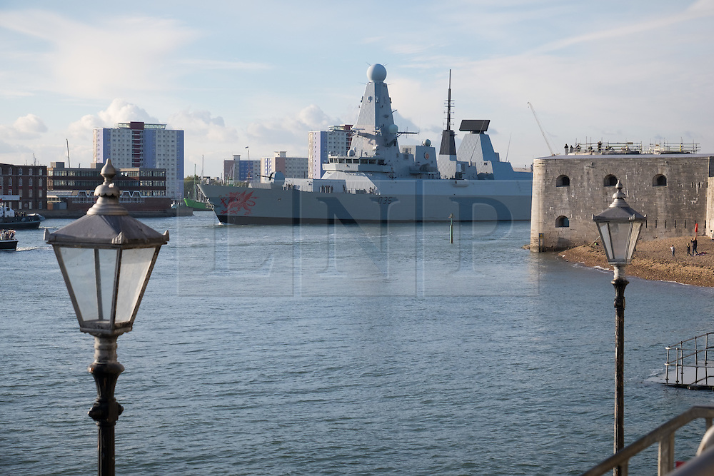 © Licensed to London News Pictures. 21/10/2016. Portsmouth, UK.  The Type 45 destroyer, HMS Dragon, leaves Portsmouth Harbour this afternoon to intercept and escort two Russian corvettes sailing north towards the English Channel from the Bay of Biscay. The move comes during a time when Royal Navy ships HMS Duncan and HMS Richmond are actively involved with escorting eight Russian navy ships through the English Channel as they make their way to the Mediterranean. Photo credit: Rob Arnold/LNP