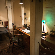 General Sir Hastings Ismay's Office in Room 61 Right at the Churchill War Rooms in London. The museum, one of five branches of the Imerial War Museums, preserves the World War II underground command bunker used by British Prime Minister Winston Churchill. Its cramped quarters were constructed from a converting a storage basement in the Treasury Building in Whitehall, London. Being underground, and under an unusually sturdy building, the Cabinet War Rooms were afforded some protection from the bombs falling above during the Blitz.