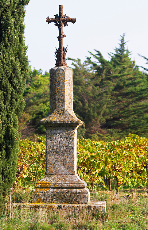 Commemorative cross on stone base saying Mire l'Etang 10 October 1894 (year is uncertain) Chateau Mire l'Etang. La Clape. Languedoc. France. Europe.